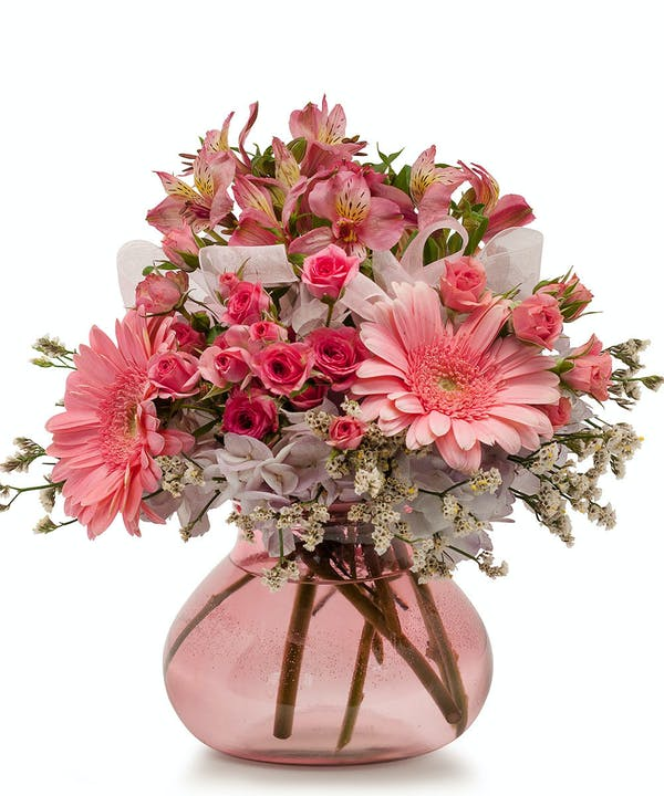 The most joyful flowers youll ever receive shotwell floral and alstroemeria is arranged in a round pink tinted glass vase for maximum sweetness celebrate the happy couple and their new baby girl with an amazing mightylinksfo